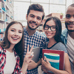 Selfie time! Four international students with beaming smiles are
